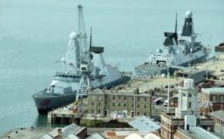 Type 45 destroyers HMS Dragon, left, and HMS Diamond
