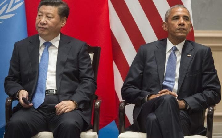 Barack Obama and Chinese president Xi Jinping in Hangzhou, after formally joining the Paris Climate deal at the G20 summit on Saturday
