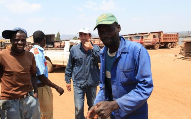 Gho Feng gives thumbs up at tobacco farm