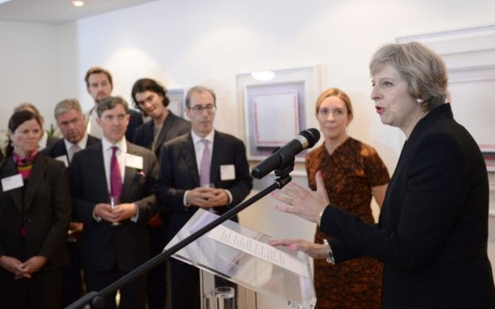 Theresa May speaks to American business leaders, accompanied by Antonia Romeo, British Consul General, in New York