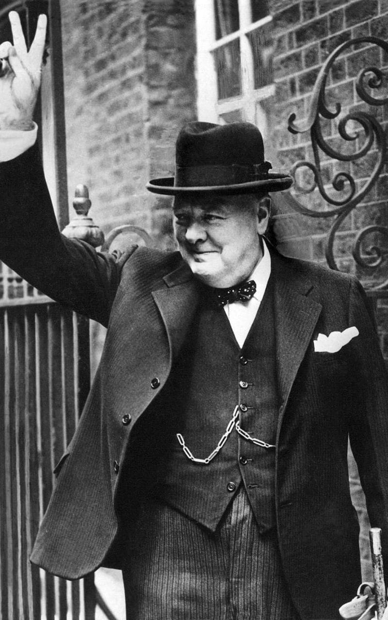"""Sir Winston Churchill, is photographed with the famous V for """"victory"""" in 10 Downing Street after his return to London in 1943"""