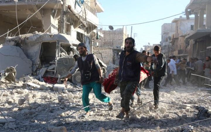 Volunteers carry an injured person on a stretcher following Syrian government airstrikes on the rebel held neighbourhood of Heluk in Aleppo last week.