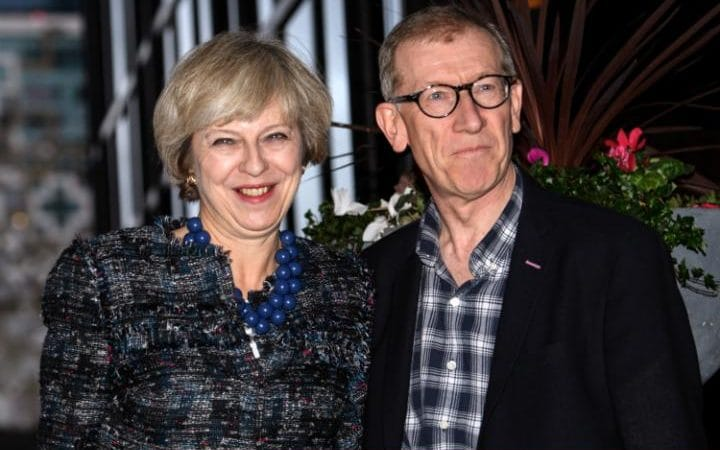 Theresa May and her husband Philip arrive at their hotel for the Conservative Party conference in Birmingham