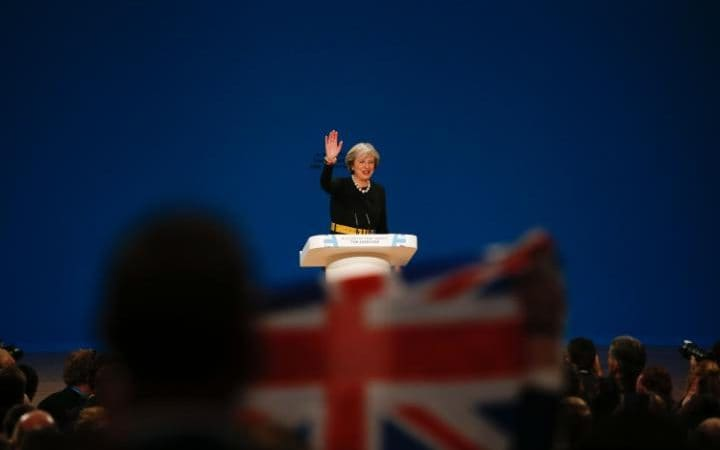 Theresa May delivers a speech on the first day of the Conservative Party's annual conference in Birmingham
