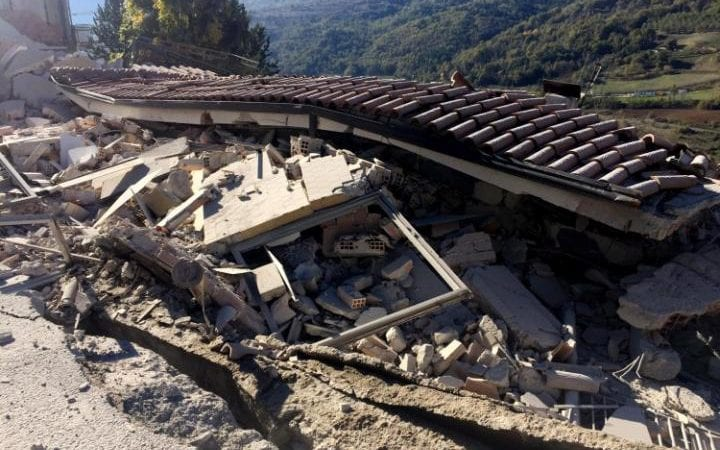 A building damaged in L'Aquila after the strong earthquake in central Italy