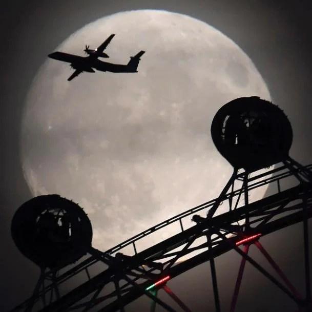 An aeroplane flies past the London Eye on Sunday