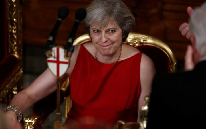 Theresa May reacts to applause after making her speech at the Lord Mayor's Banquet