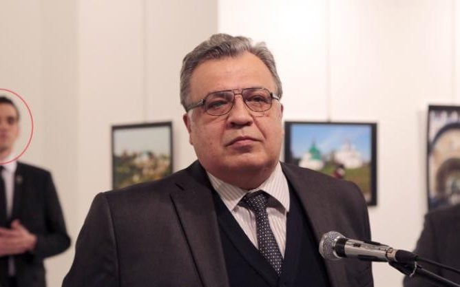 Melvut Mert Altintas watches Andrey Karlov speak at a gallery in Ankara shortly before the attack on Monday night