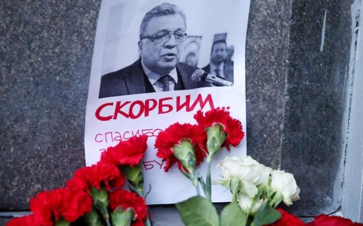Flowers at the entrance to the Russian Foreign Ministry pay tribute to the murdered ambassador Andrei Karlov