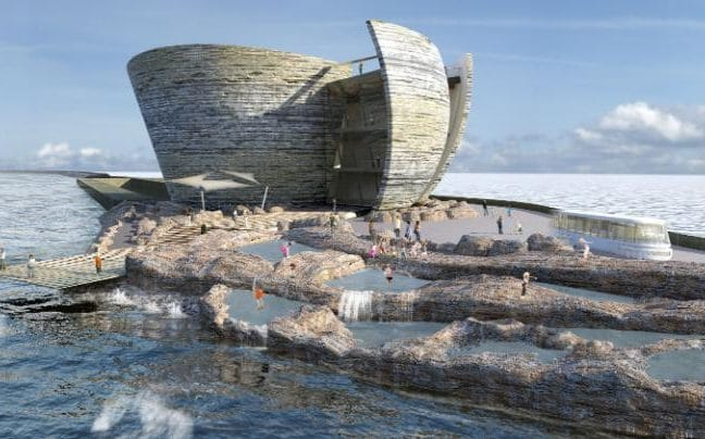 A futuristic building made up of concentric layers sits atop a sea wall
