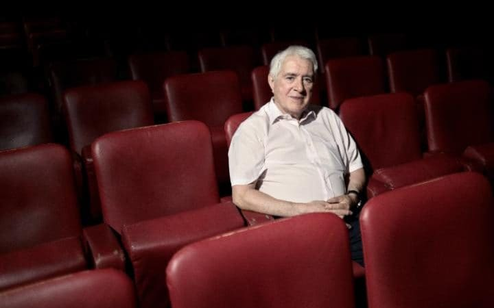 Mr Laroche poses in the theatre.
