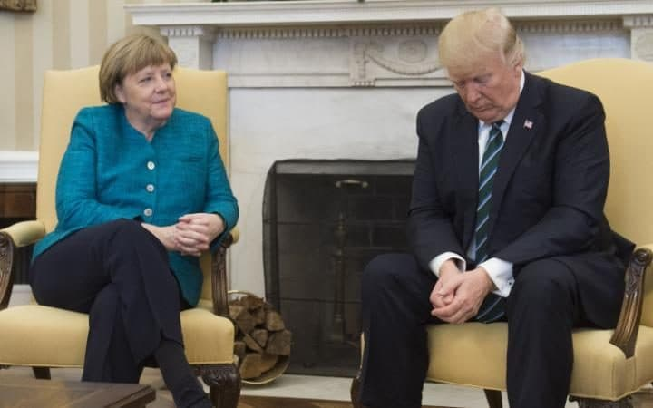 US President Donald Trump and German Chancellor Angela Merkel meet in the Oval Office of the White House in Washington