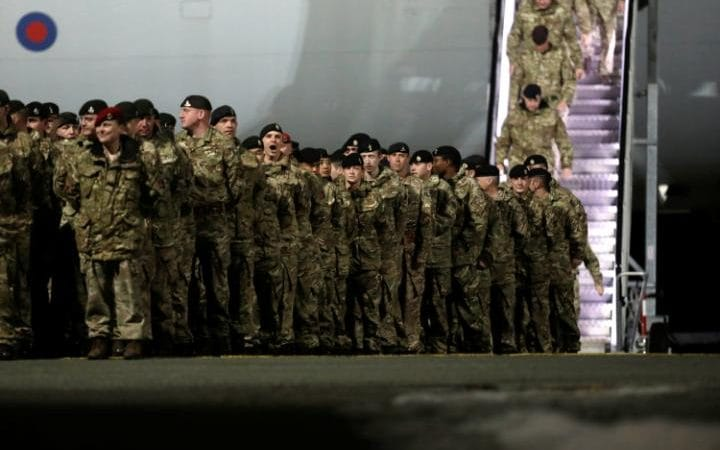 British soldiers, who are part of a NATO deterrent against Russia, arrive at Amari military air base in Estonia