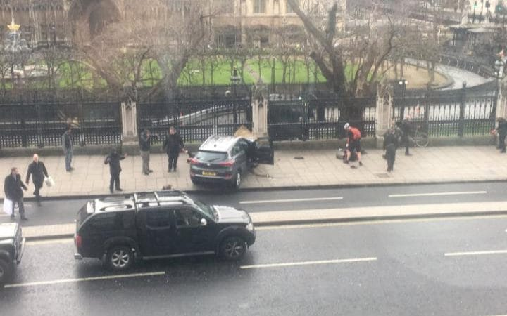 The attacker's Hyundai 4x4 is seen just yards from the House of Commons after crashing into railings.