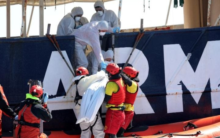 Lifeguards from the Spanish NGO Proactiva Open Arms lift the body of a migrant onto the former fishing trawler Golfo Azzurro during a search and rescue operation in the Mediterranean Sea