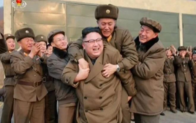 North Korea leader Kim Jong-un gives a piggyback to a soldier