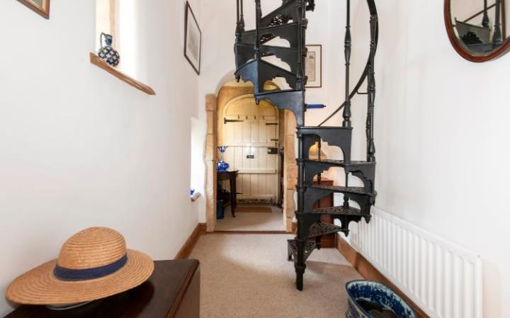 The winding staircase leads up to the turret