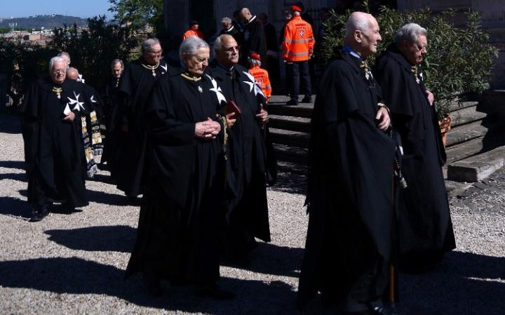 Former Grand Master Matthew Festing, second left, defied a Vatican order to stay away from Saturday's vote