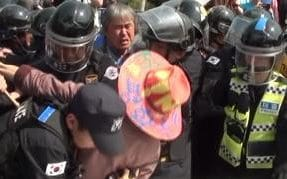 A protester fights with police amid the demonstration
