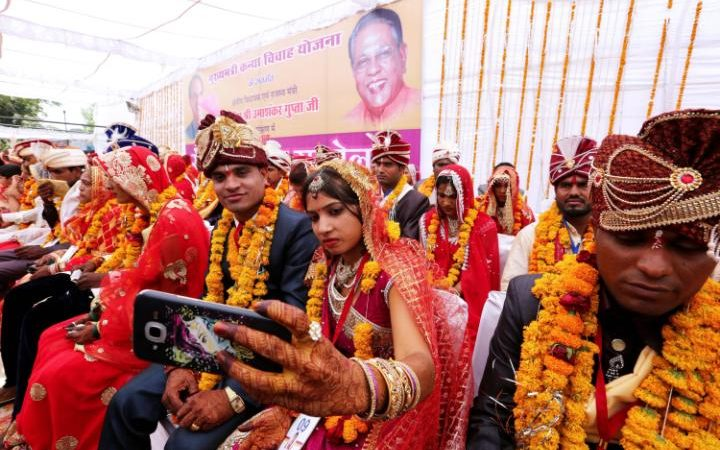 Image result for 700 brides given bats to beat abusive husbands