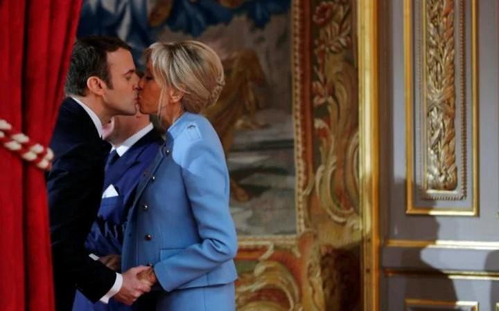 Emmanuel Macron kisses his wife Brigitte Trogneux