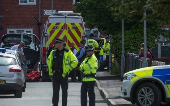 Police seal off Elsmore Road in Manchester and search an address further down the street in the aftermath of the Arena bombing
