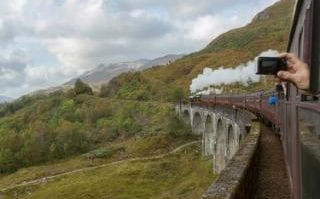 The Jacobite Steam Train making its way along the Glenfinnan Viaduct on the West Highland Line, in Lochaber, Scotland