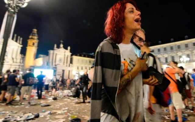 Juventus supporters evacuate Piazza San Carlo after a panic movement in the fanzone where thousands of Juventus fans were watching the UEFA Champions League Final