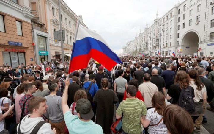 Participants of an unauthorised opposition rally gather in Tsverskaya street in central Moscow