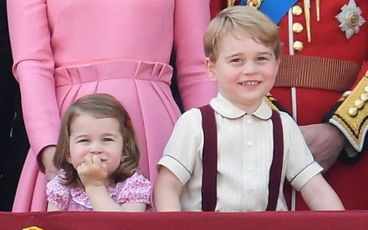 Prince George and Princess Charlotte watch air show from the balcony of Buckingham Palace
