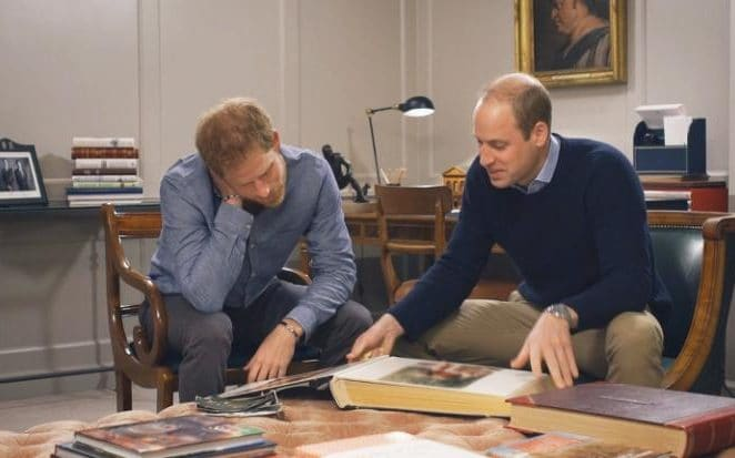 The Princes looking through old family albums