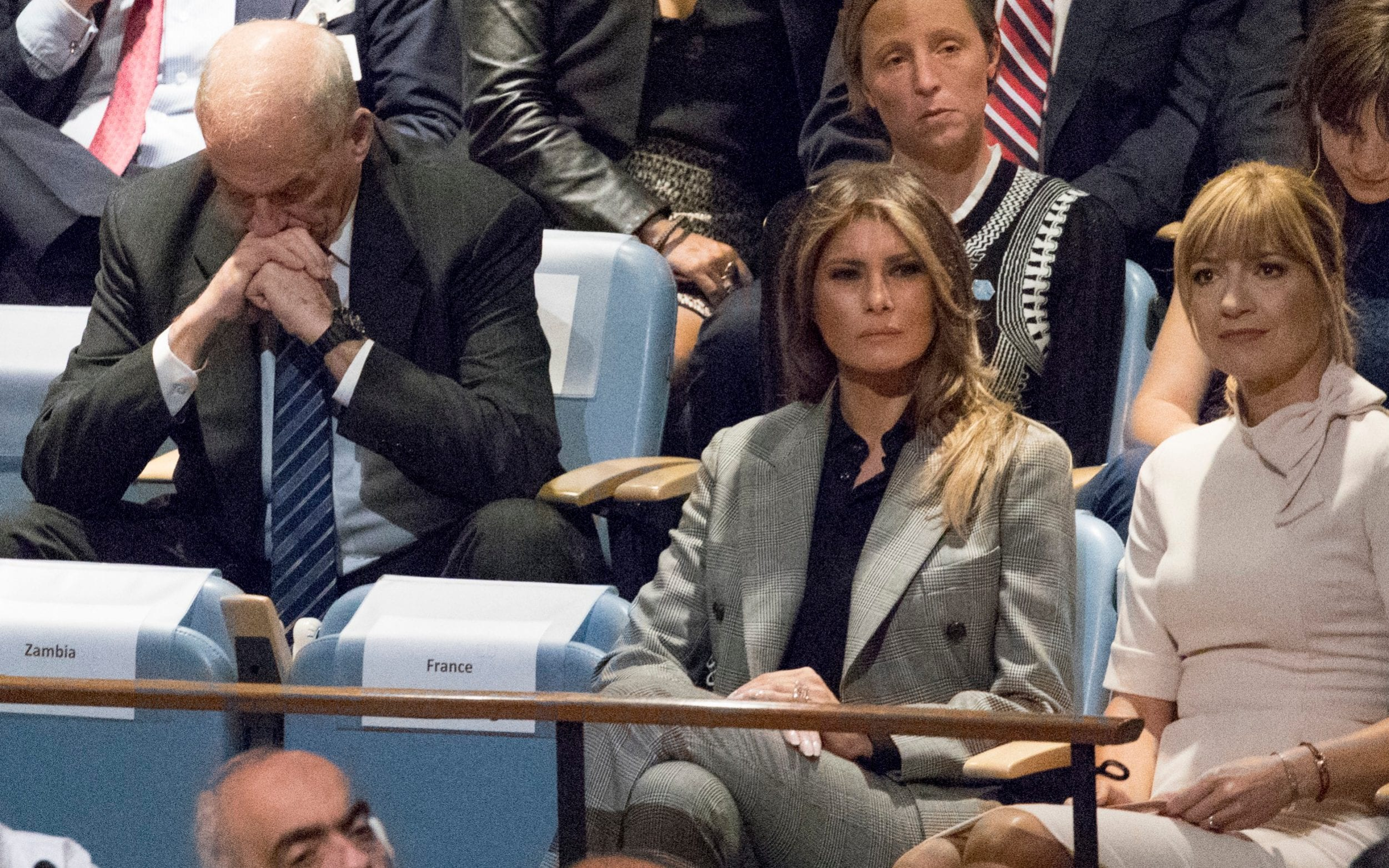 White House Chief of Staff John Kelly, left, reacts as he and first lady Melania Trump listen to U.S. President Donald Trump speak at the United Nations General Assembly