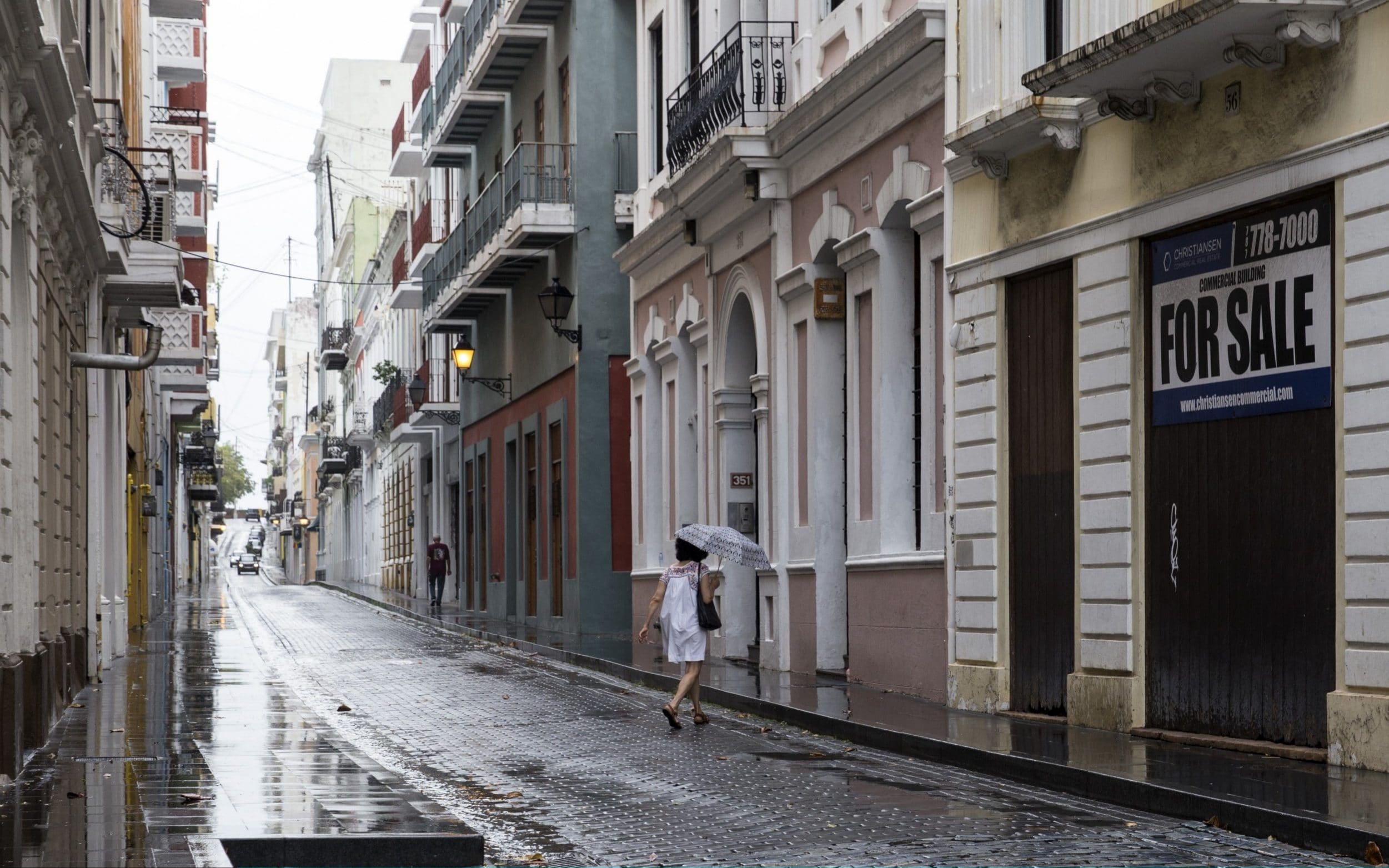 People walk along the nearly deserted streets of Old San Juan as residents prepare for a direct hit from Hurricane Maria