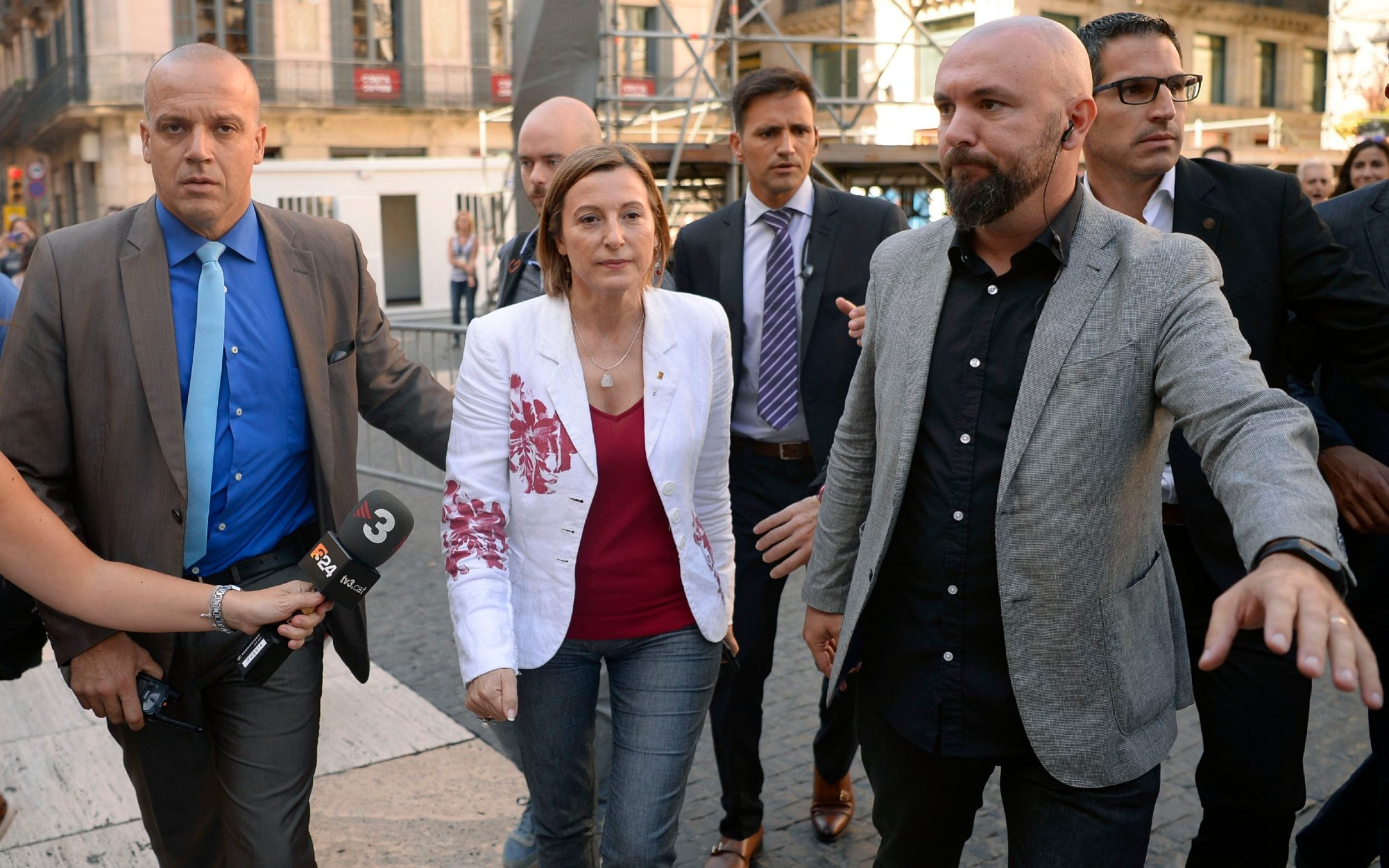 The President of the Catalan parliament Carme Forcadell (C) leaves the headquarters of the Catalan regional government