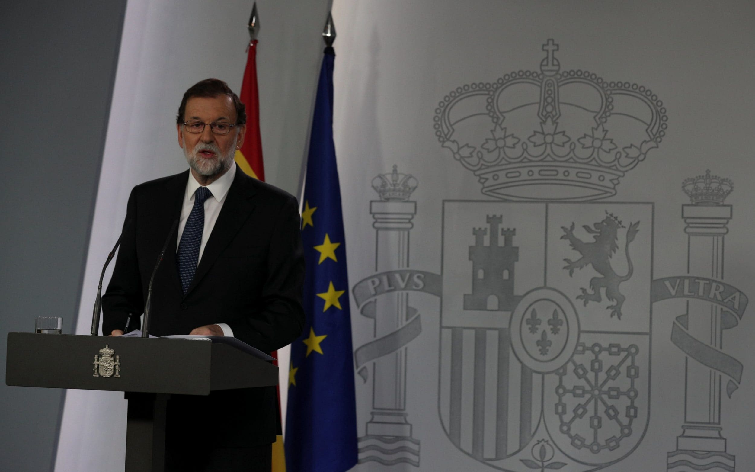 Spain's Prime Minister Mariano Rajoy delivers a statement at the Moncloa Palace in Madrid
