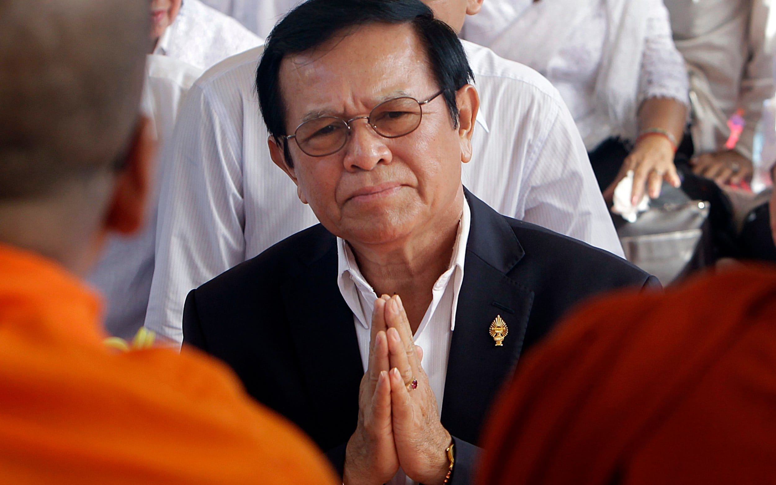 In this March 30, 2017, file photo, leader of the opposition Cambodia National Rescue Party Kem Sokha prays during a Buddhist ceremony to mark the 20th anniversary of the attack on anti-government protesters in 1997, in Phnom Penh, Cambodia