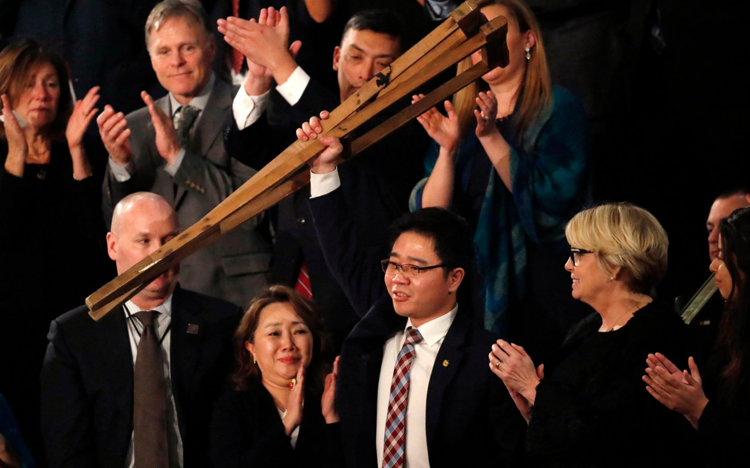 North Korean defector Ji Seong-ho is acknowledged by U.S. President Trump as he delivers his State of the Union address in Washington
