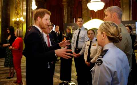 Prince Harry talks to members of the Australian Defence Force
