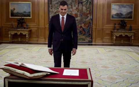Spain's new Prime Minister and Socialist party (PSOE) leader Pedro Sanchez walks during his swearing in ceremony at the Zarzuela Palace in Madrid