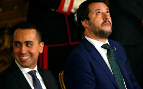Italy's deputy prime ministers Luigi Di Maio (L) and Matteo Salvini (R) have been baiting French president Emmanuel Macron for months