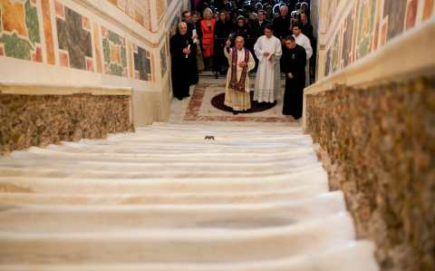 A Catholic cardinal blesses the restored Holy Stairs (Scala Santa), which according to Catholic Church tradition is the staircase which Christ climbed on his way to being condemned to death