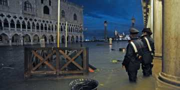 Venice mayor blames climate change as flooded city hit by highest tide in 50 years
