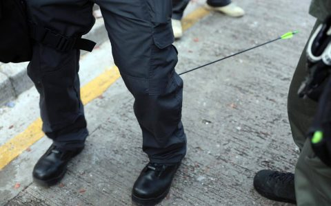An officer was hit in the calf by an arrow fired by protesters outside the Polytechnic University of Hong Kong