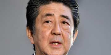 Shinzo Abe mired in cherry blossom party scandal as he becomes longest-serving Japanese prime minister