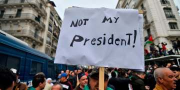 Huge crowds protest in Algeria's capital as loyalist of deposed leader elected president
