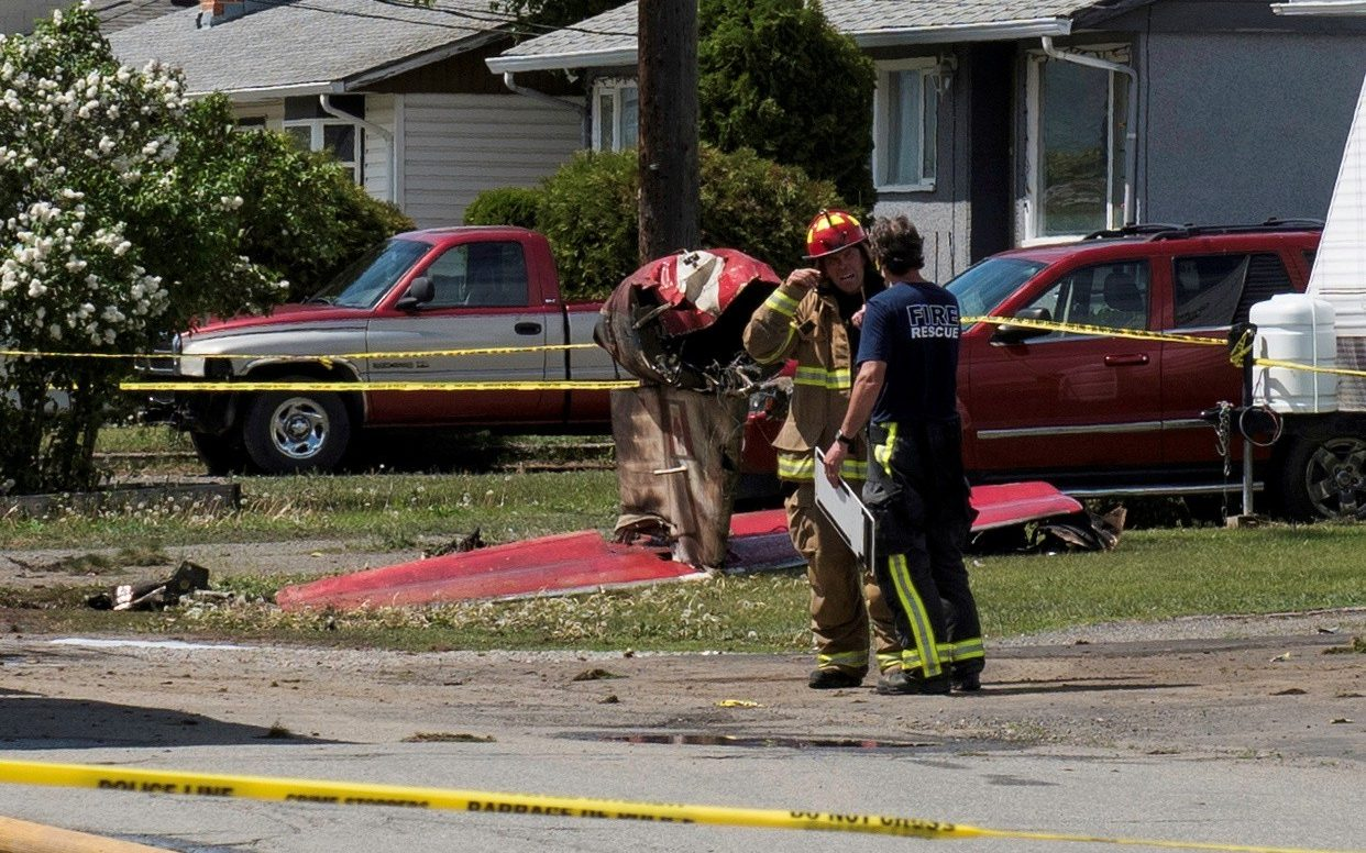 One person dead after Canadian acrobatic jet crashes and sets a house on fire