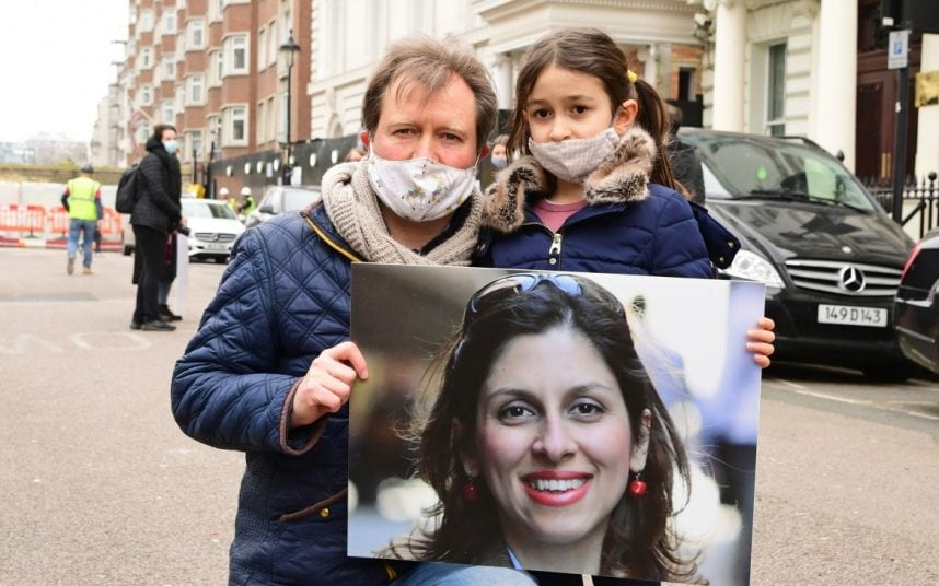 Richard Ratcliffe and his daughter hold a picture of Nazanin outside the Iranian embassy