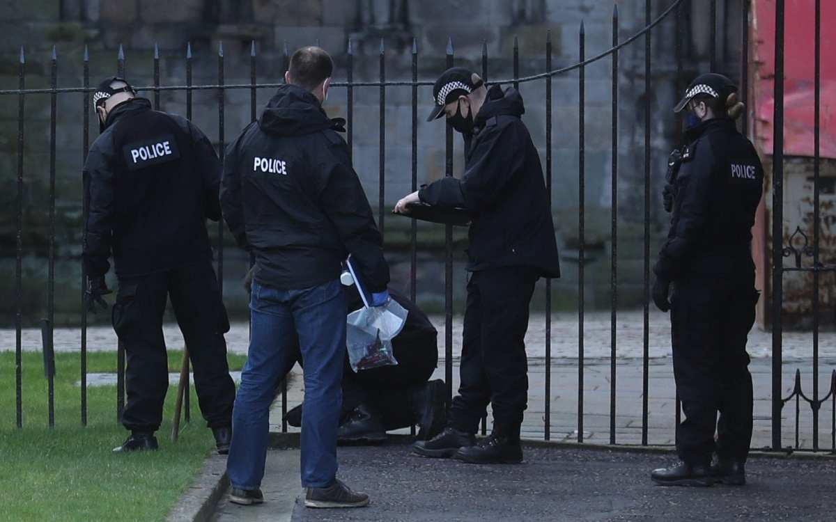 Police officers search the grounds of the Palace of Holyroodhouse