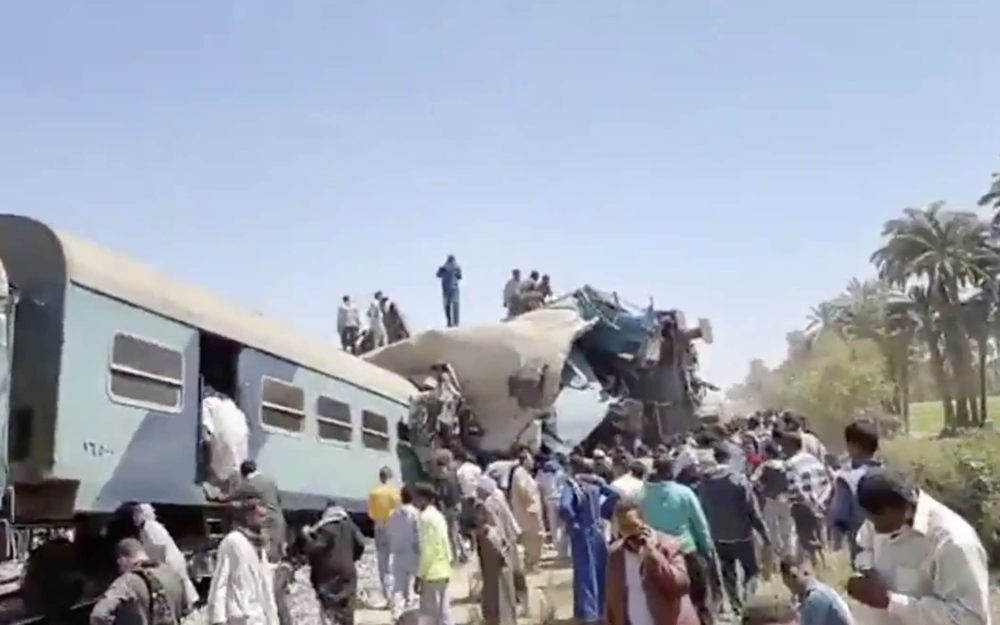 Train crash in Egypt: at least 32 people dead after head-on collision