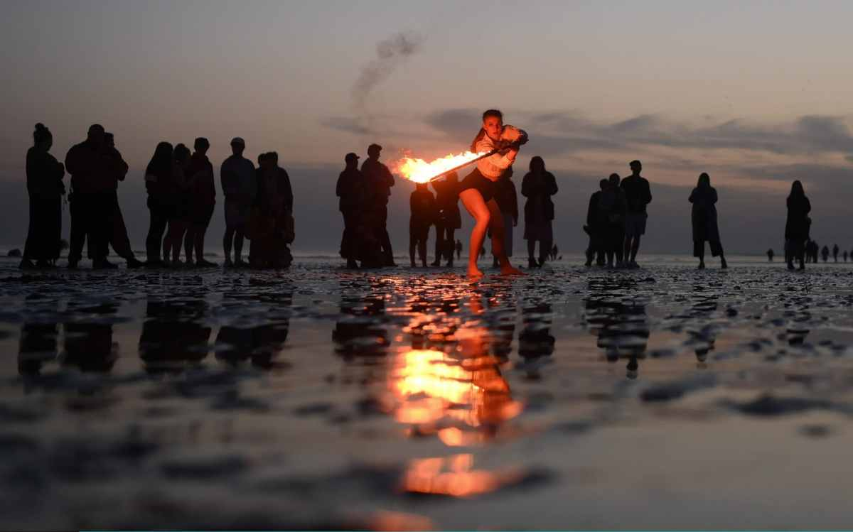 A fire juggler performs on Brighton beach on Tuesday evening